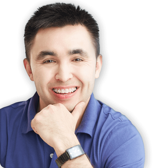 Smiling man with self-litigating braces