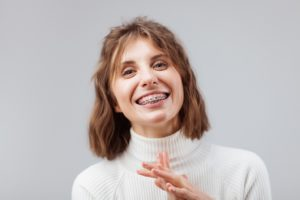 Woman with braces, thinking about braces treatment time