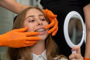 Young woman at appointment to repair broken braces